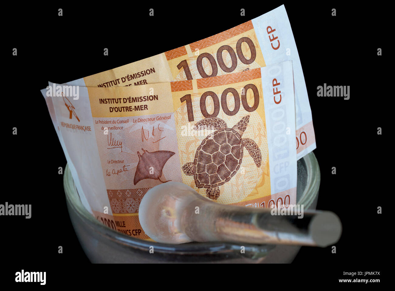 French Polynesian francs in a glass mortar