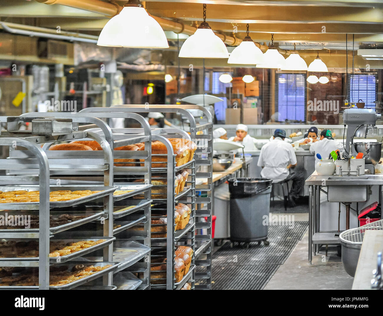 Bakery workers taking a coffee break at a Chelsea Market bakery in Manhattan. - Stock Image