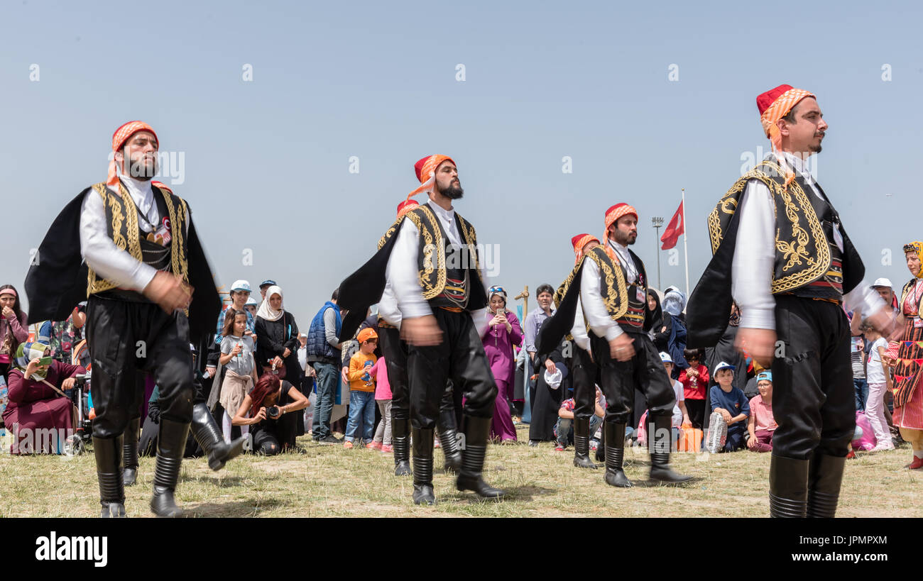 Unidentified people playing traditional folklore with their ethnic clothes at a show.It is popular in Turkey.ISTANBUL, TURKEY, May 13, 2017 Stock Photo