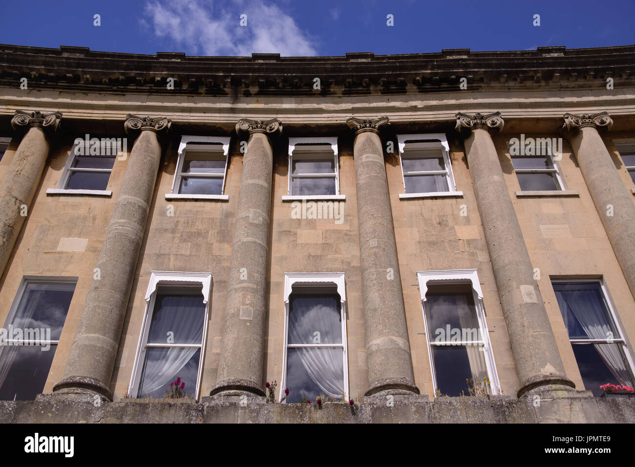 Looking up on the facade of the Royal Cresent in Bath. The arc isn't from distortion it is from the fact that the building is build as a semicircle. , - Stock Image