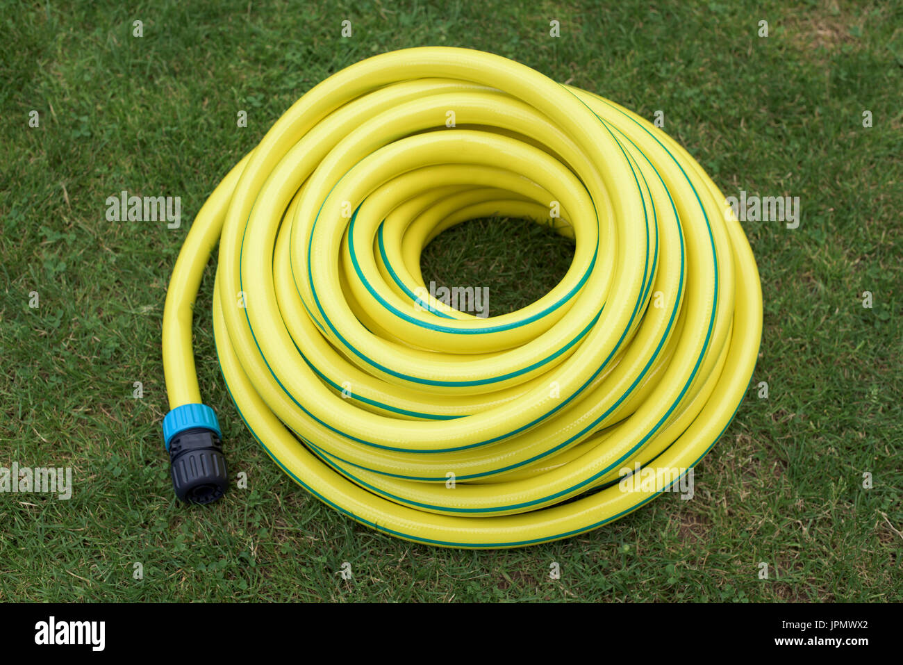 Yellow plastic water pipe on a green grass - Stock Image & Plastic Water Pipe Stock Photos u0026 Plastic Water Pipe Stock Images ...