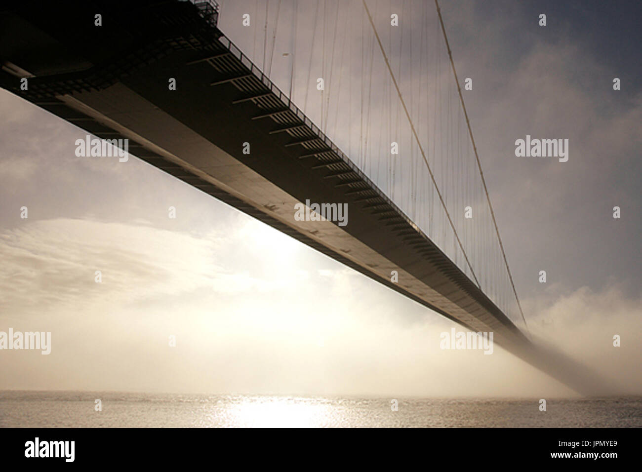 Humber bridge in fog bank, Art, humber estuary - Stock Image