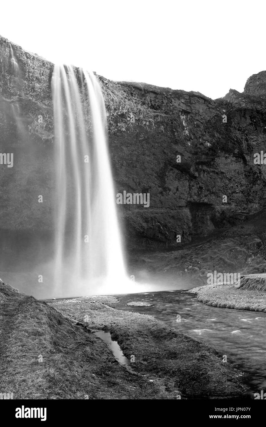 Long exposure shot of waterfall in Iceland - Stock Image