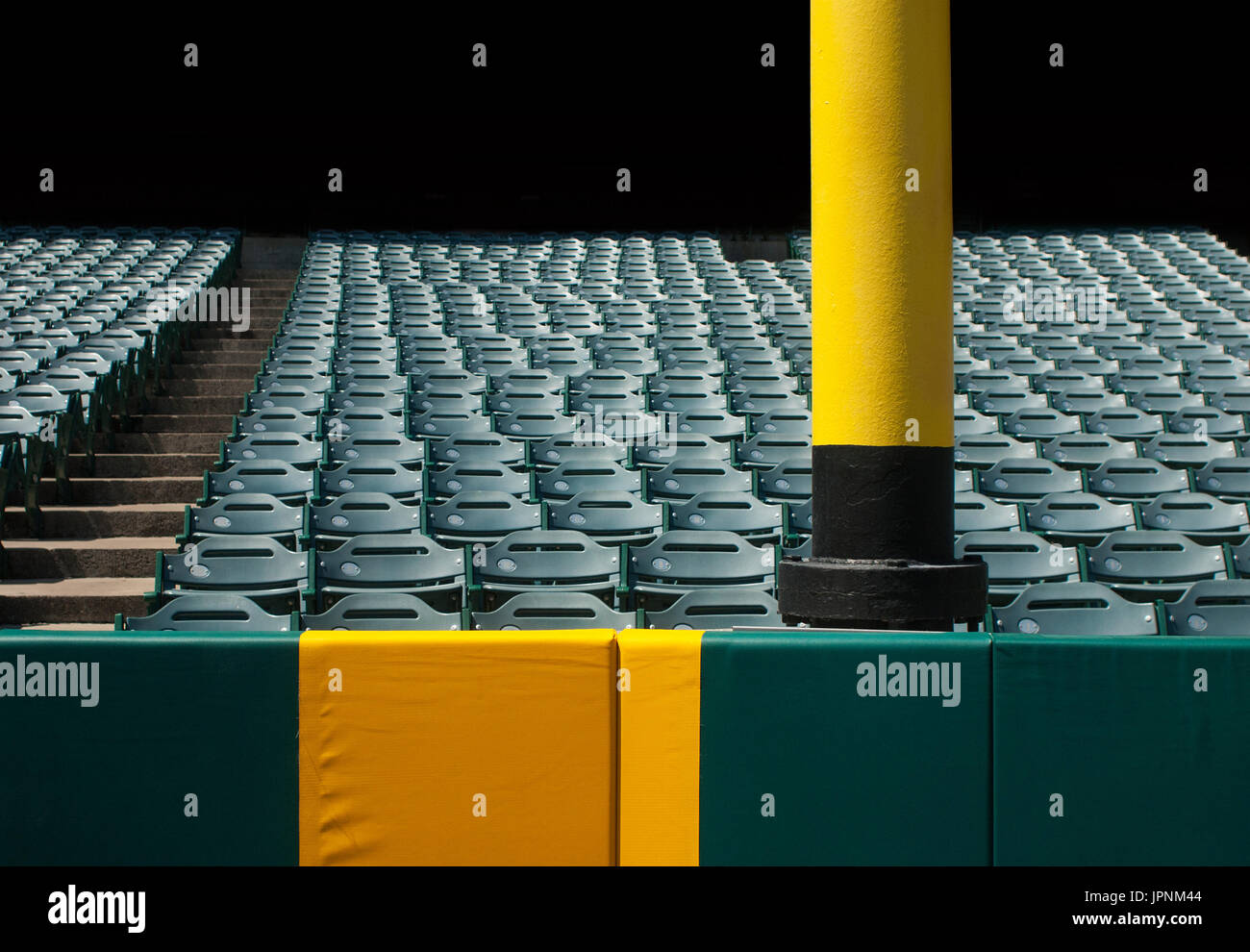 Baseball foul pole with stadium seats. - Stock Image