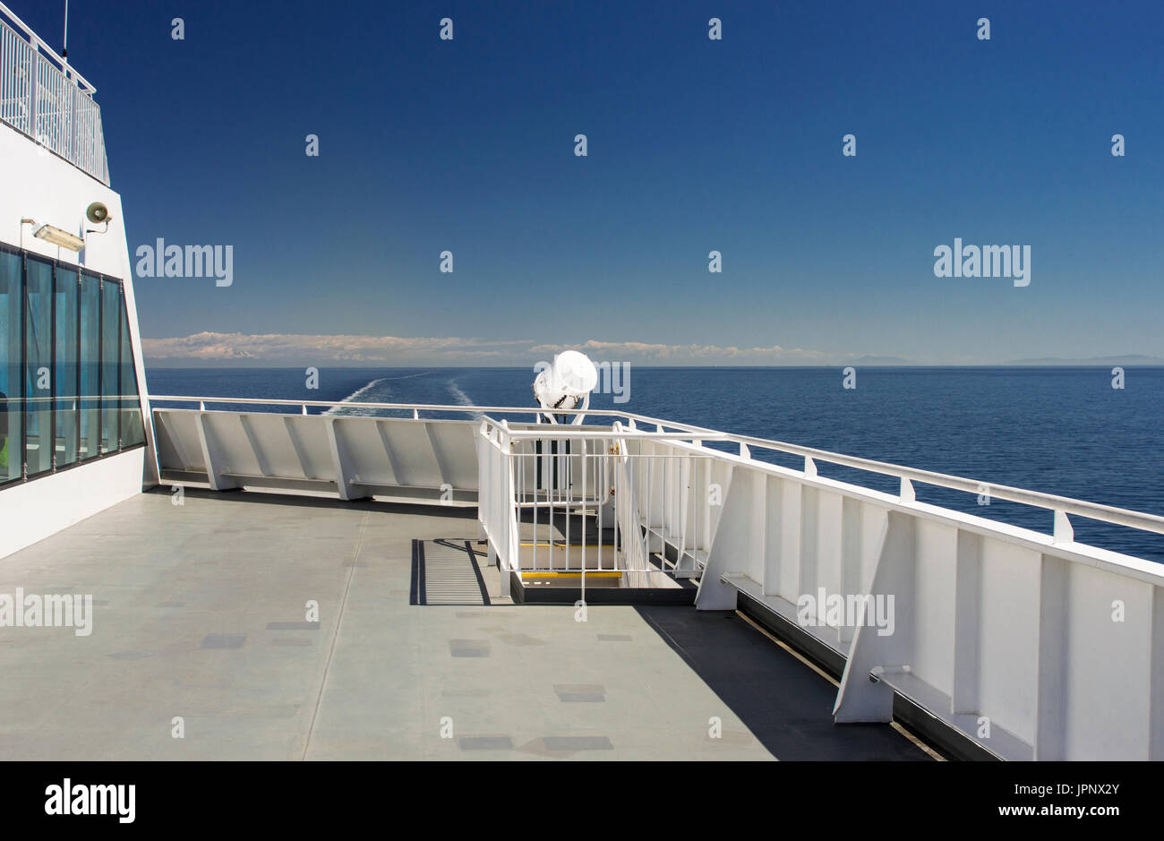 Eastern view of the Strait of Georgia from a ferry deck, BC Ferries, British Columbia, Canada on a bright sunny Stock Photo