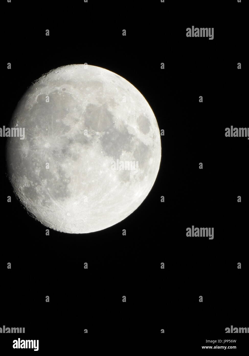 Super zoom almost full moon - Stock Image