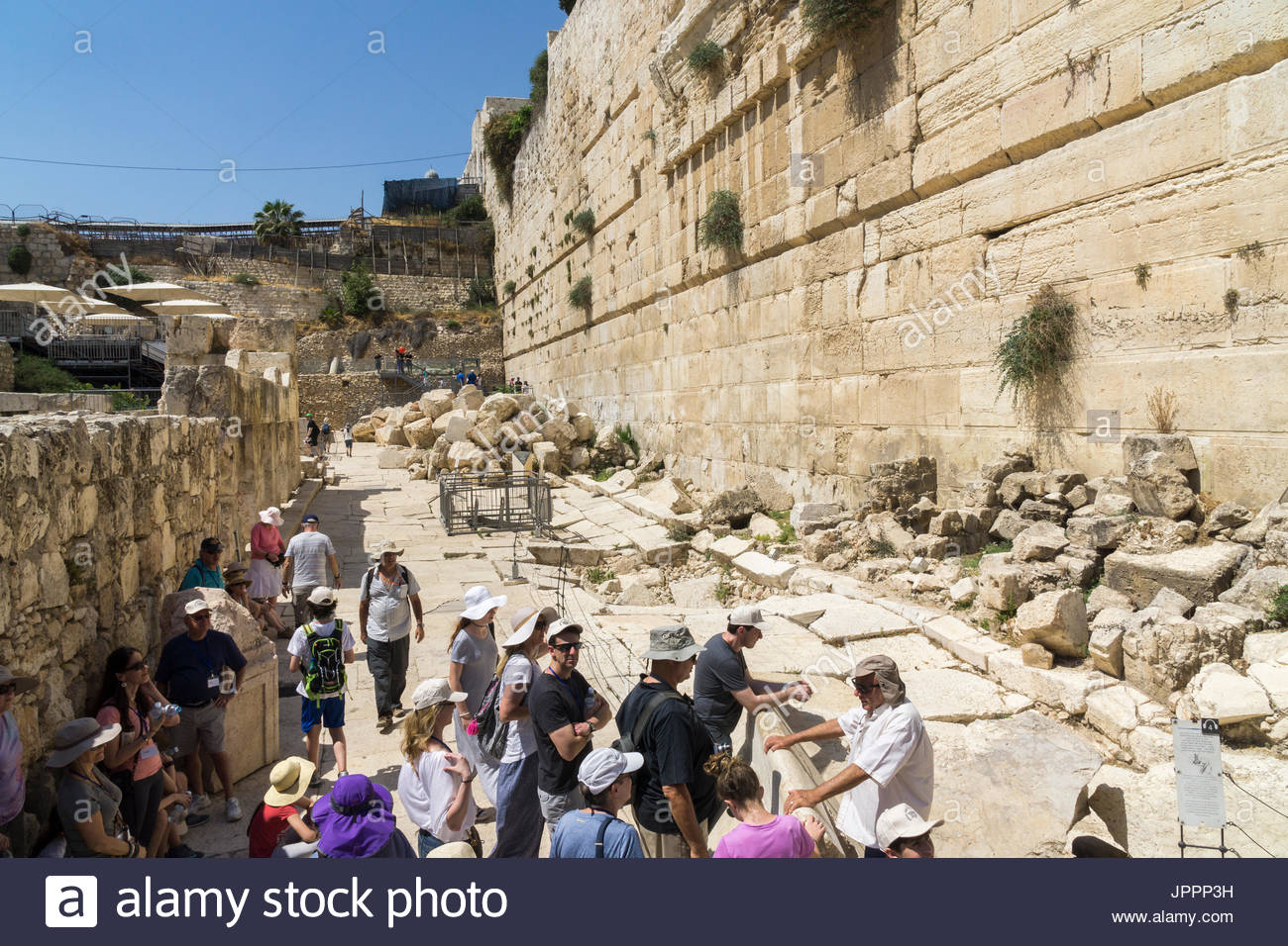 A tour group visits the Jerusalem Archaeological Park at the southern end of the Temple Mount in Jerusalem, Israel. - Stock Image