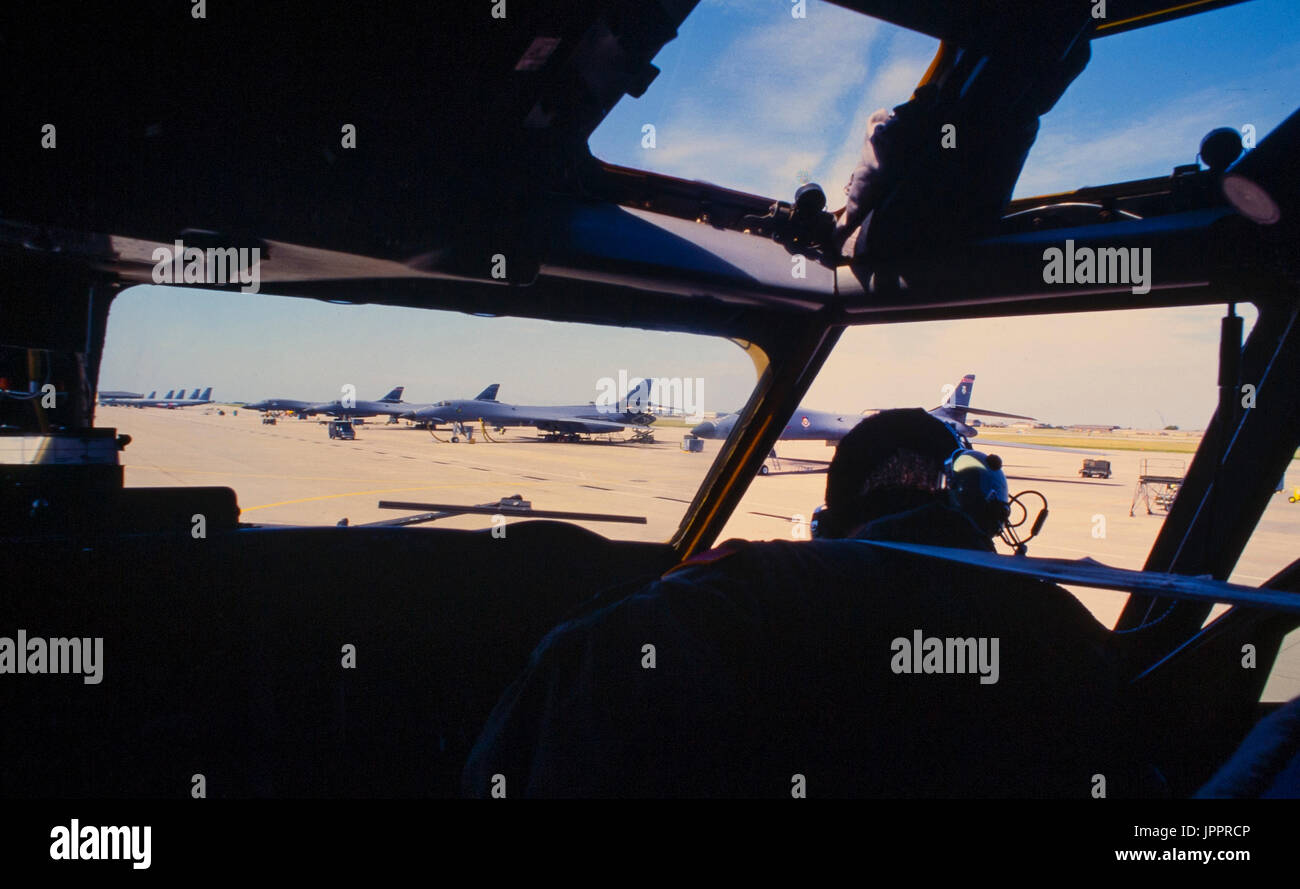 A US Air Force pilot taxis his KC-135 tanker past the flightline filled with U.S. Air Force Lancer B-1 bombers. Stock Photo