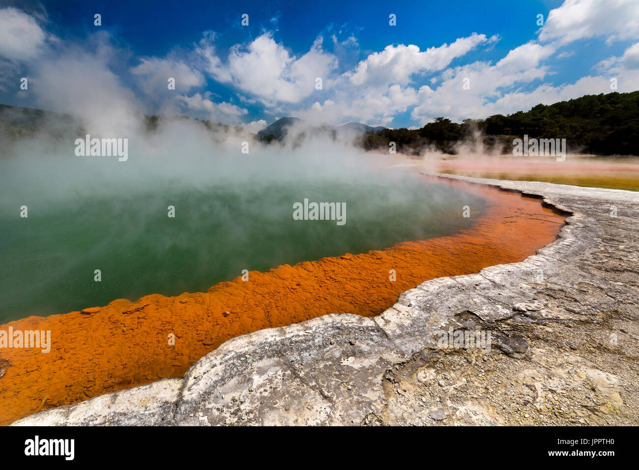 Steaming hot water at the Champagne Pool, Waiotapu Thermal Reserve, Rotorua, North Island New Zealand - Stock Image