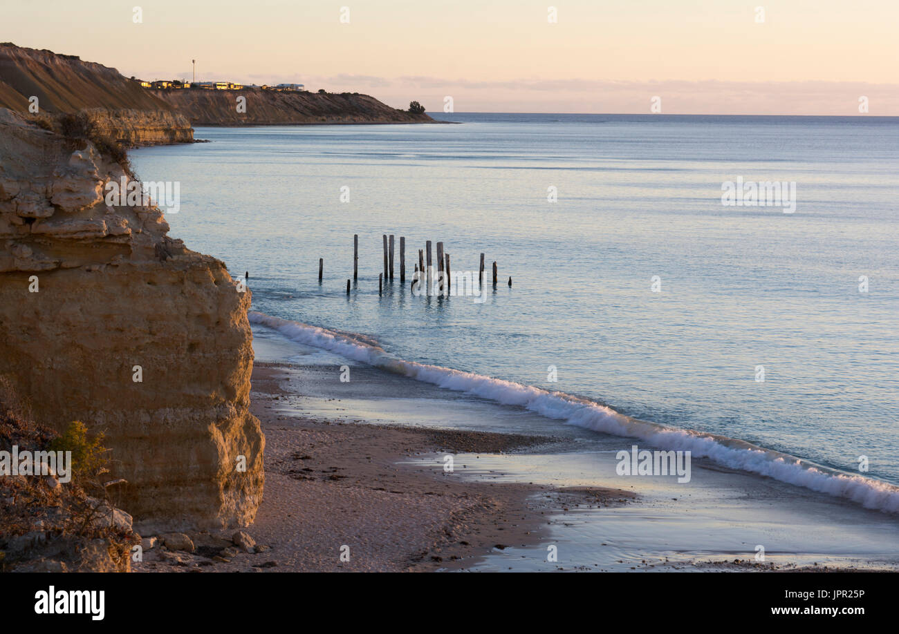 Looking down at the jetty ruins at Port Willunga, South Australia, during the golden hour, nearing sunset and at Stock Photo