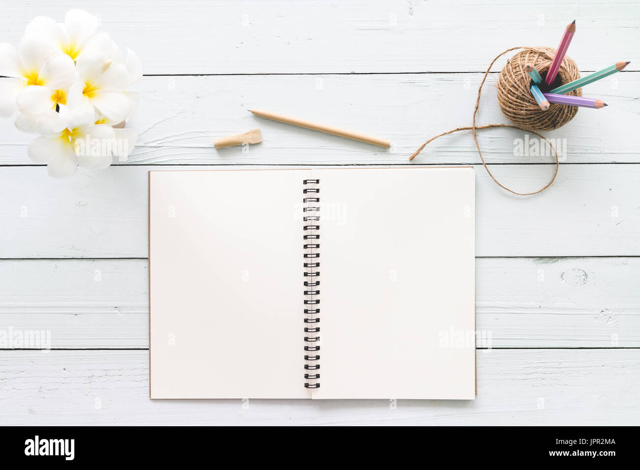Modern White Office Desk Top Wood Table With Notebook, Notepad And Other  Supplies. Top View With Copy Space On White Background. Top View, Flat Lay.