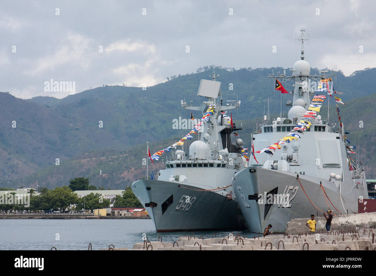 Dili, East Timor. Chienese warships in Dili harbour - Stock Image