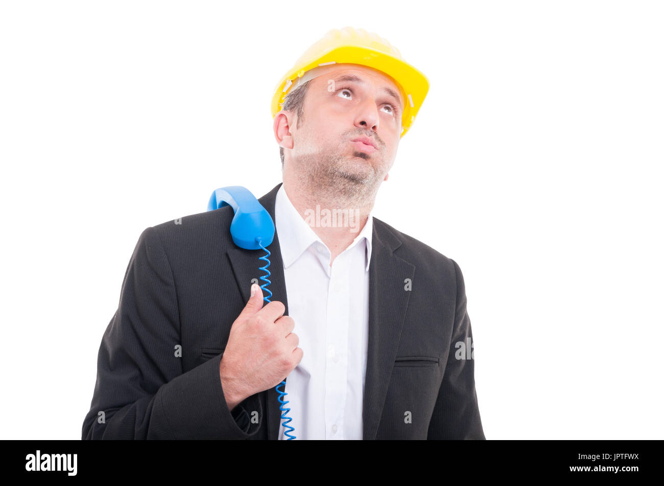 a1599f64e Architect looking bored with telephone receiver on shoulder wearing yellow  hardhat isolated on white background -