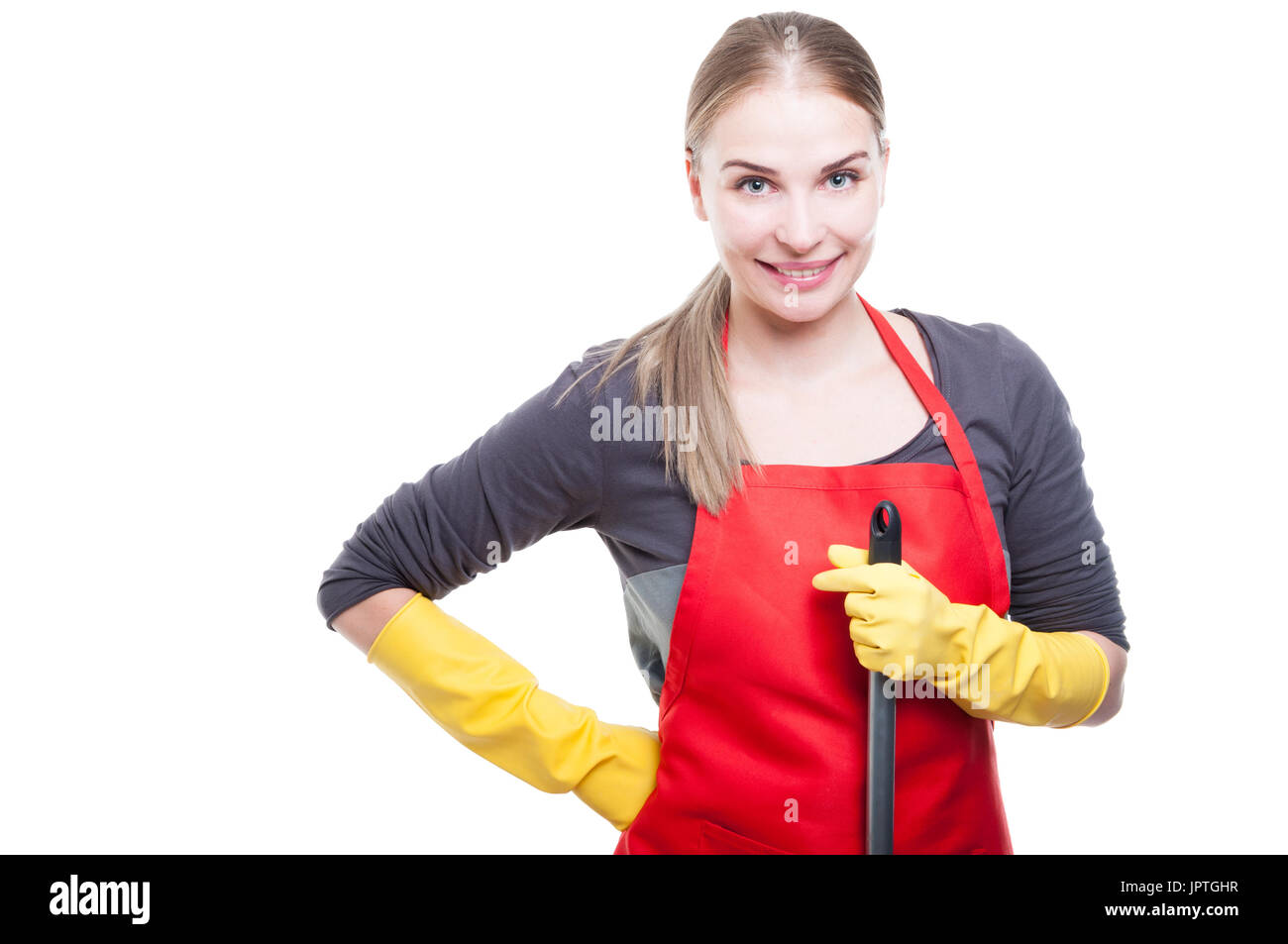 Portrait of smiling housekeeper holding mop for cleaning housework isolated on white background - Stock Image