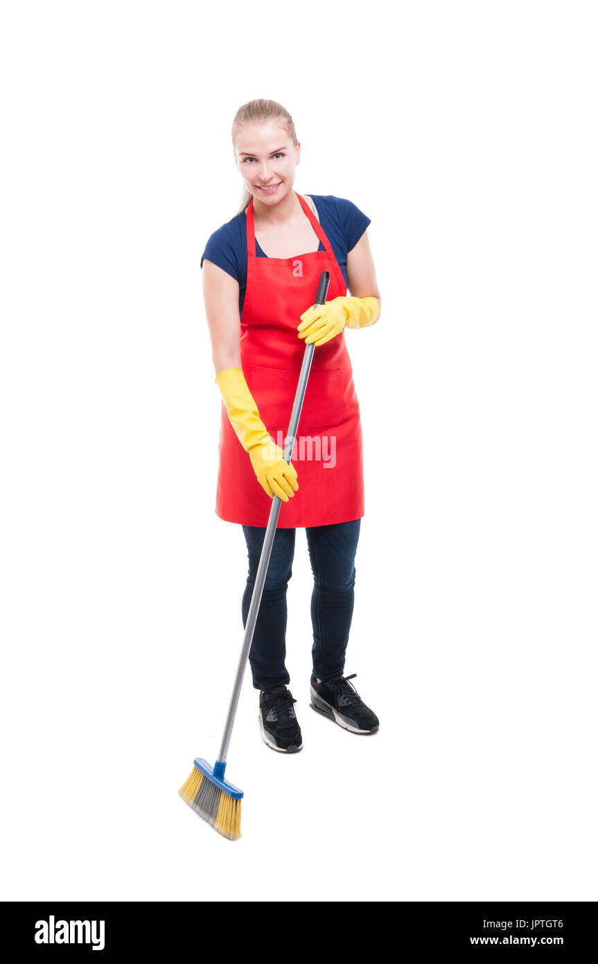 Beautiful housekeeper sweeping the floor and doing the chores isolated on white background Stock Photo