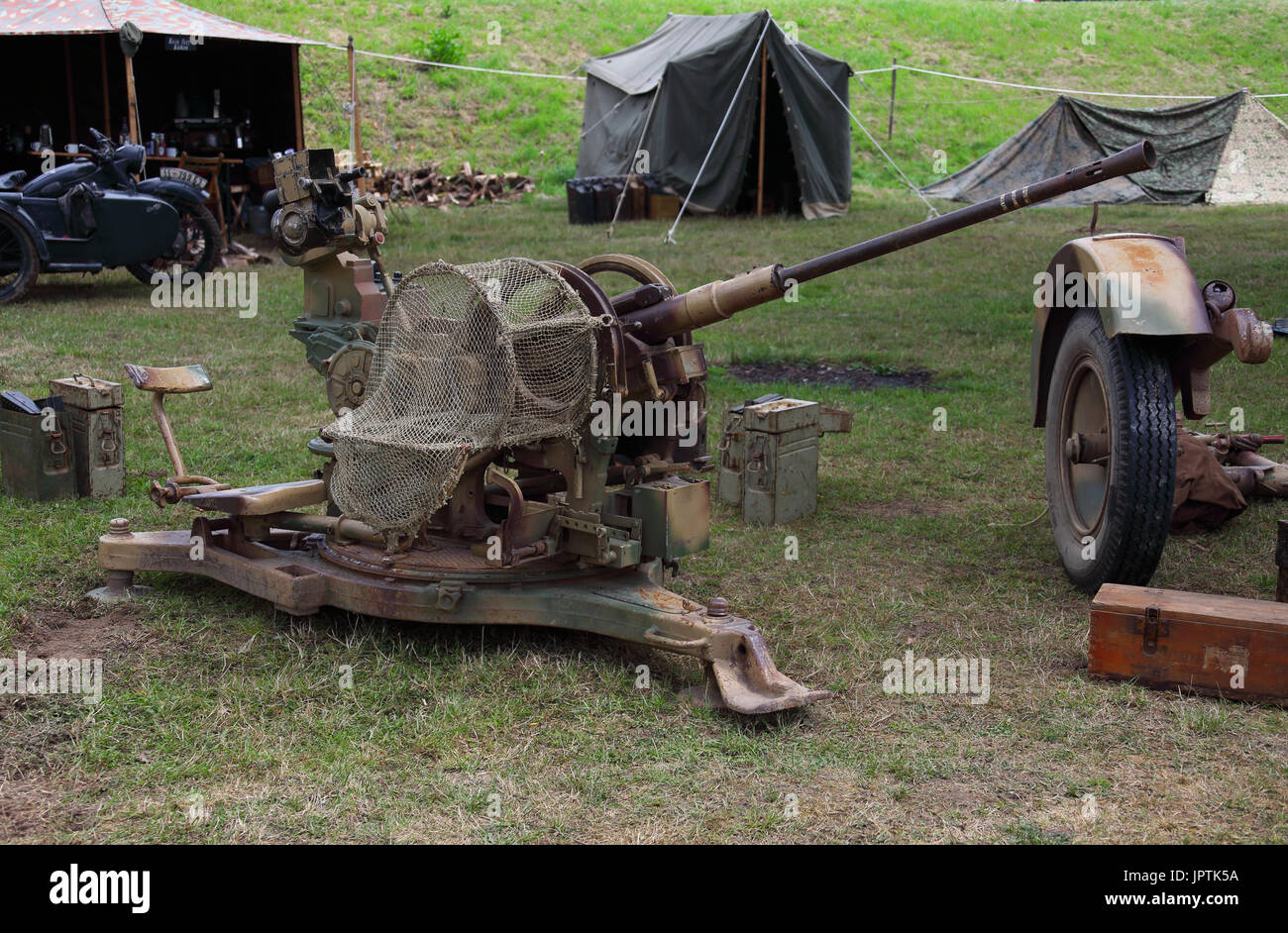 A well preserved German automatic anti aircraft gun form world war 2 on display at Beltring, the wheels it normally travels on have been dismounted. - Stock Image