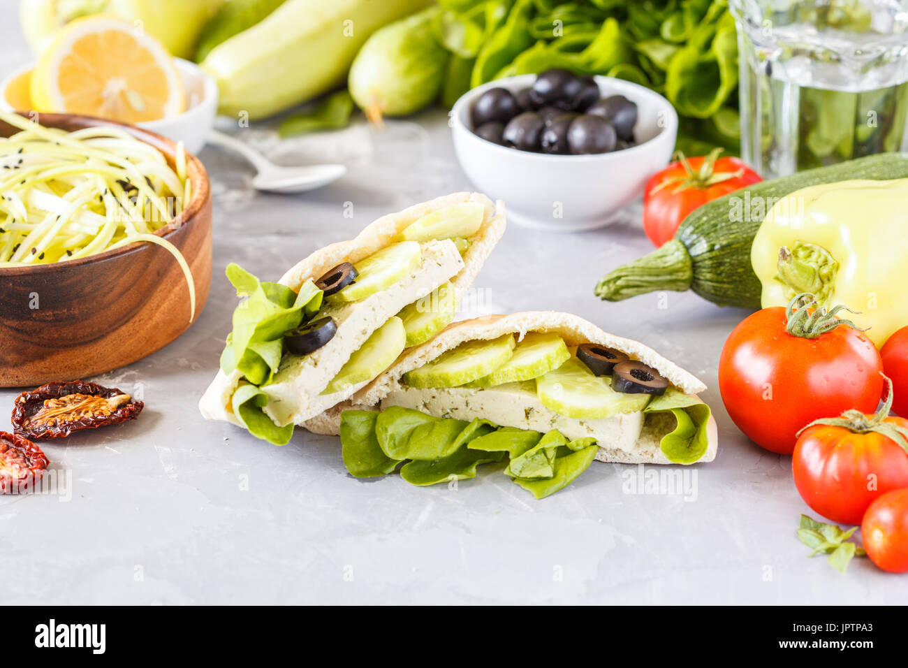 Healthy sandwiches with vegetables and tofu in pita. Love for a healthy vegan food concept. - Stock Image