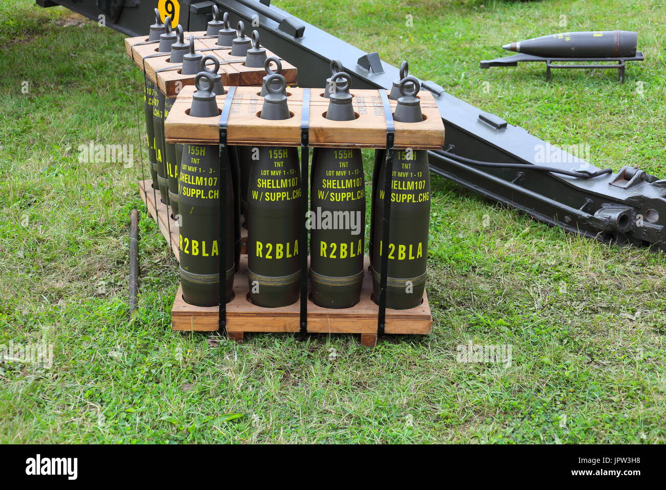 A pellet full of 155 mm Howitzer projectiles strapped up and with lifting eyes fitted in place of fuzes, all painted and stencilled with filling info. - Stock Image