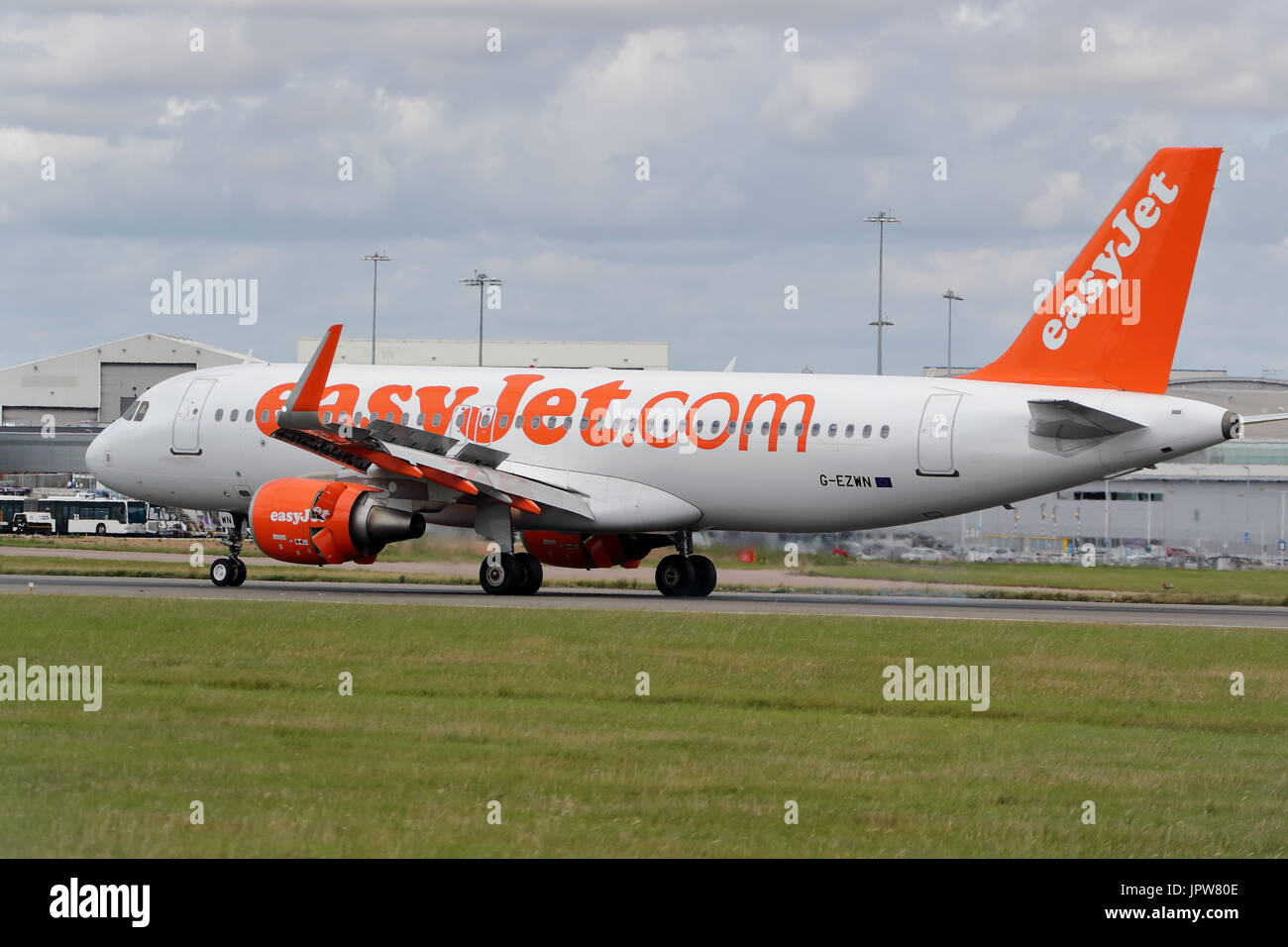 Easyjet Airbus A320 G-EZWN landing at London Luton Airport, UK - Stock Image
