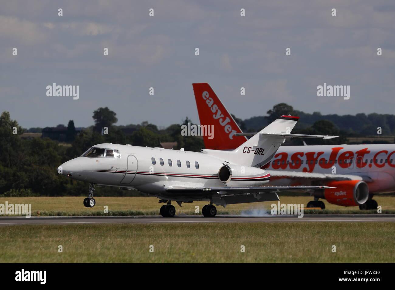 Raytheon Hawker 800XP CS-DRL business jet landing at London Luton Airport, UK - Stock Image