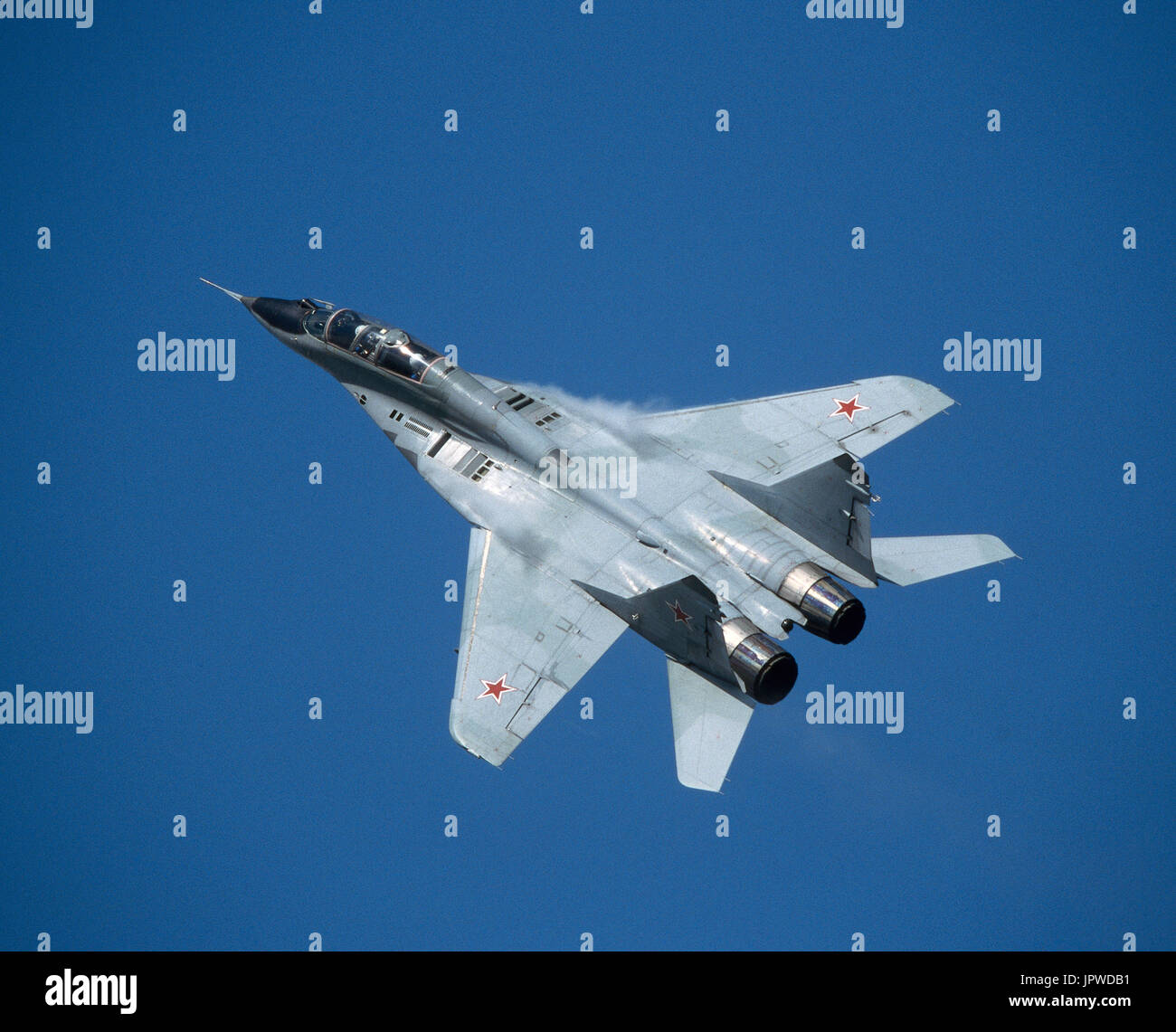 Russian AirForce Mikoyan MiG-29 Fulcrum performing a high-g pull up manoeuvre with condensation forming at the wing roots at the 1999 MAKS Airshow - Stock Image