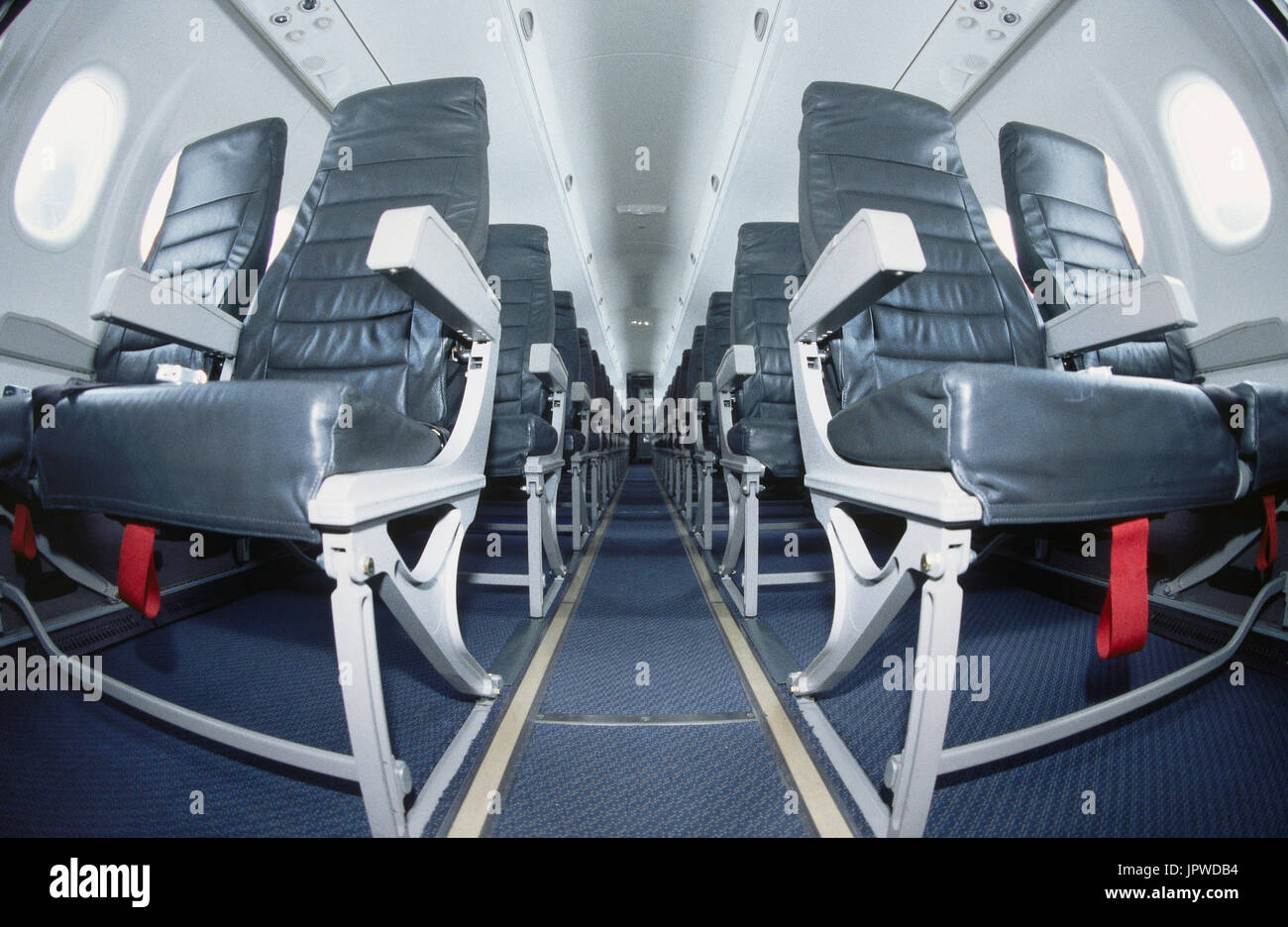 light-weight economy-class cabin leather seats and red life jacket tabs showing under seats in a SAS Bombardier DHC-8 Dash 8-400 Q400 - Stock Image
