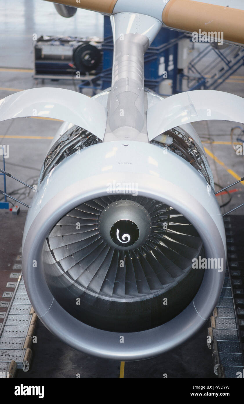 maintenance checks on the engine with cowlings open at the end of the factory production-line - Stock Image