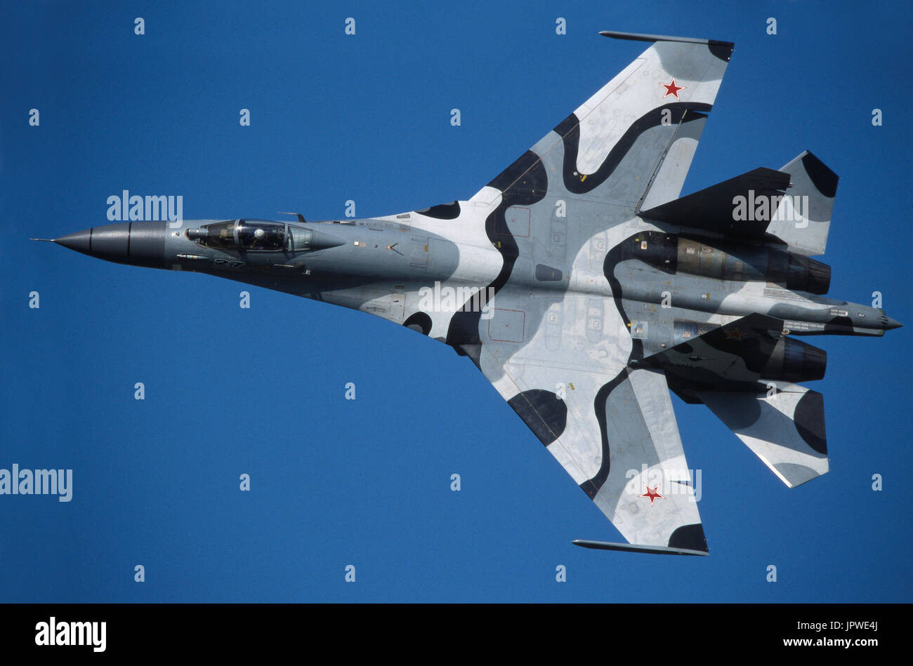 Sukhoi Su-27 Flanker in the flying-display at the 1999 Moscow Zhukovskiy Airshow banking in a steep turn with inboard ailerons deployed - Stock Image