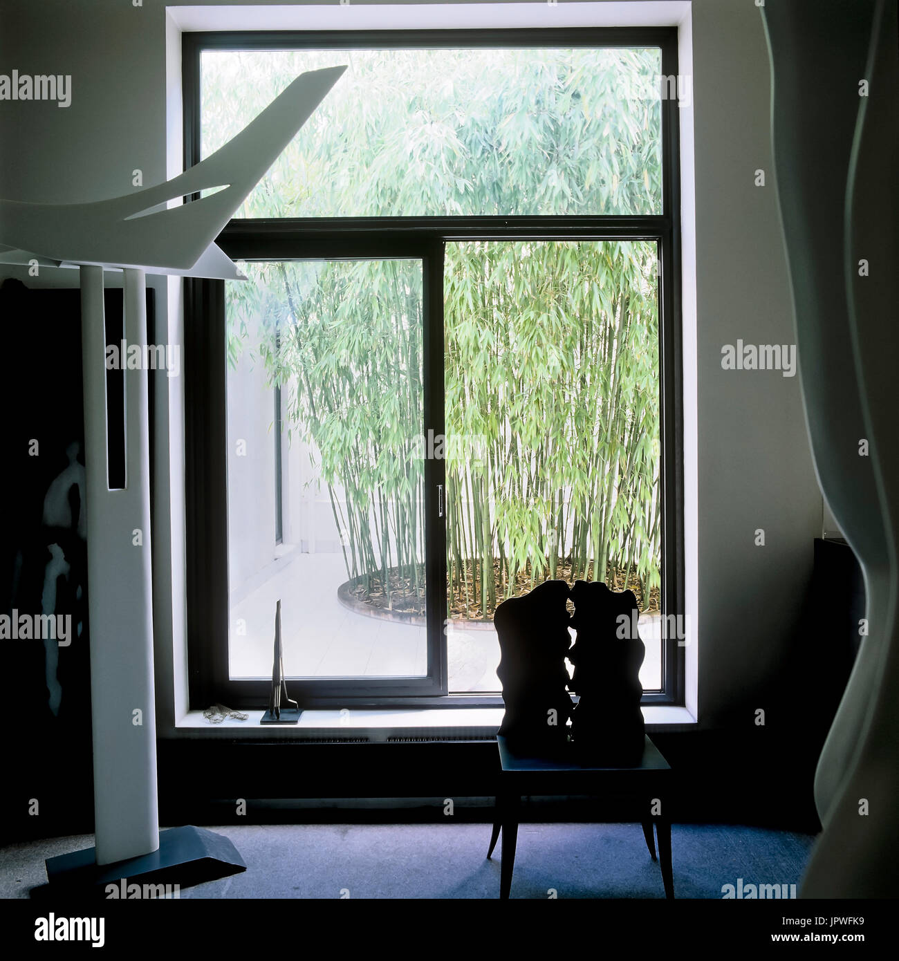 Contemporary art by window - Stock Image