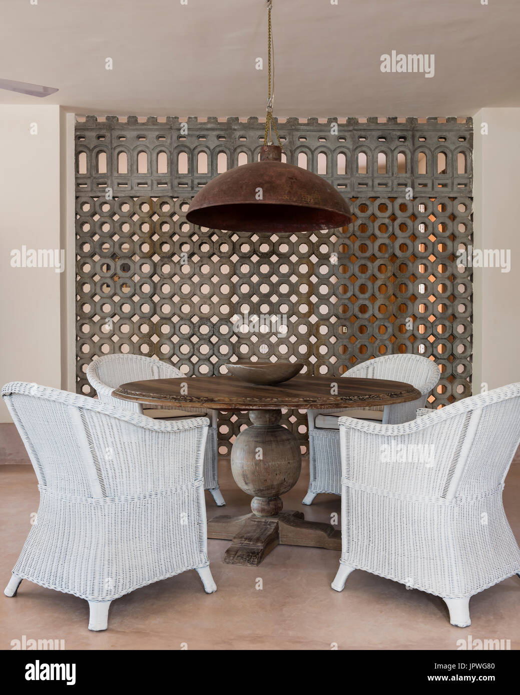 Wooden Dining Table With White Wicker Chairs Stock Photo Alamy