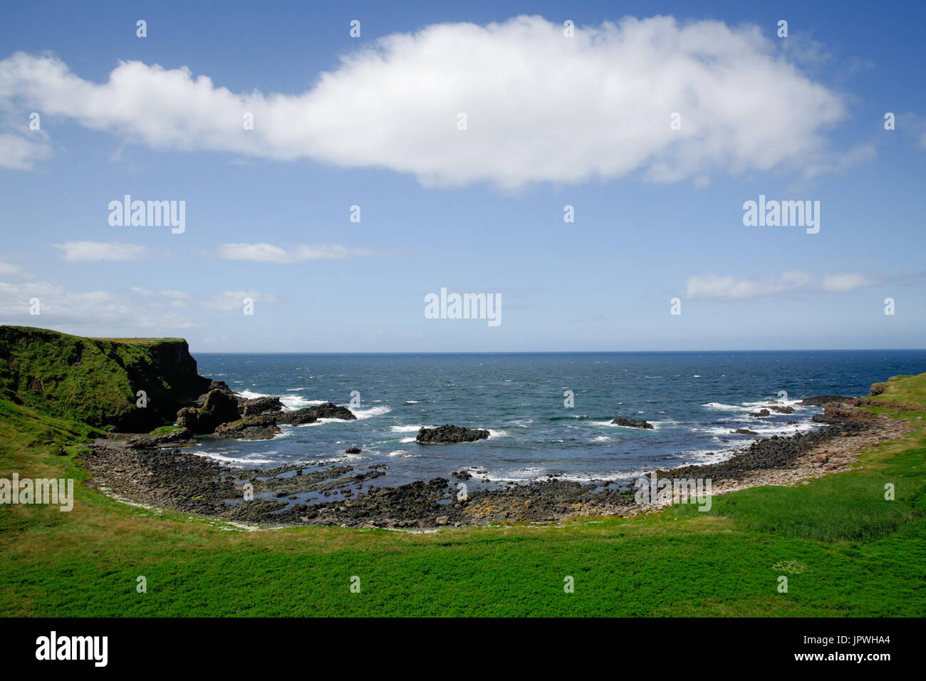 Scenic Portnaboe sits just below the Giant's Causeway Visitor's Centre and its home to famous Finn McCool's camel Bushmills Antrim Northern Ireland - Stock Image