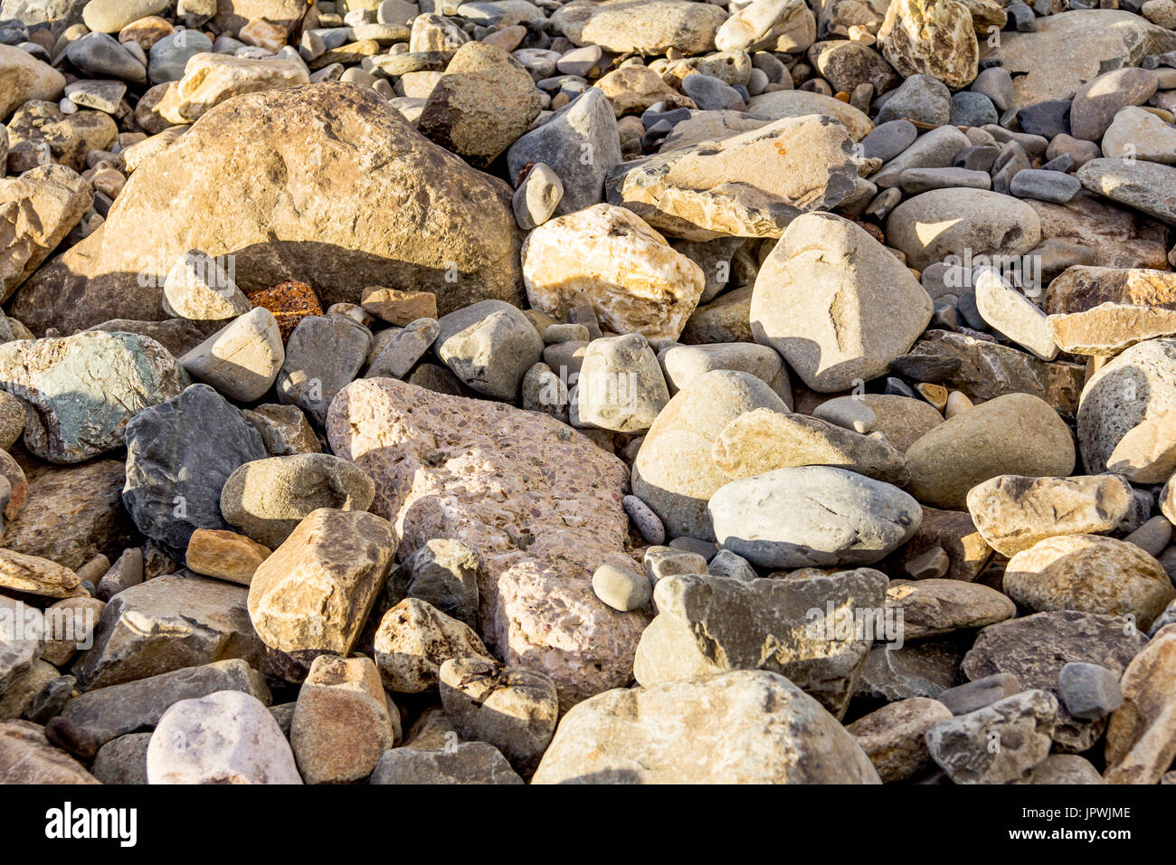 A Rocky Beach at Llanfairfechan, north Wales.  Image was taken on the 14 September 2013 on a bright sunny day. - Stock Image