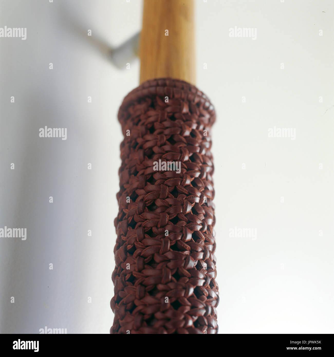 Woven leather detail on a door handle - Stock Image