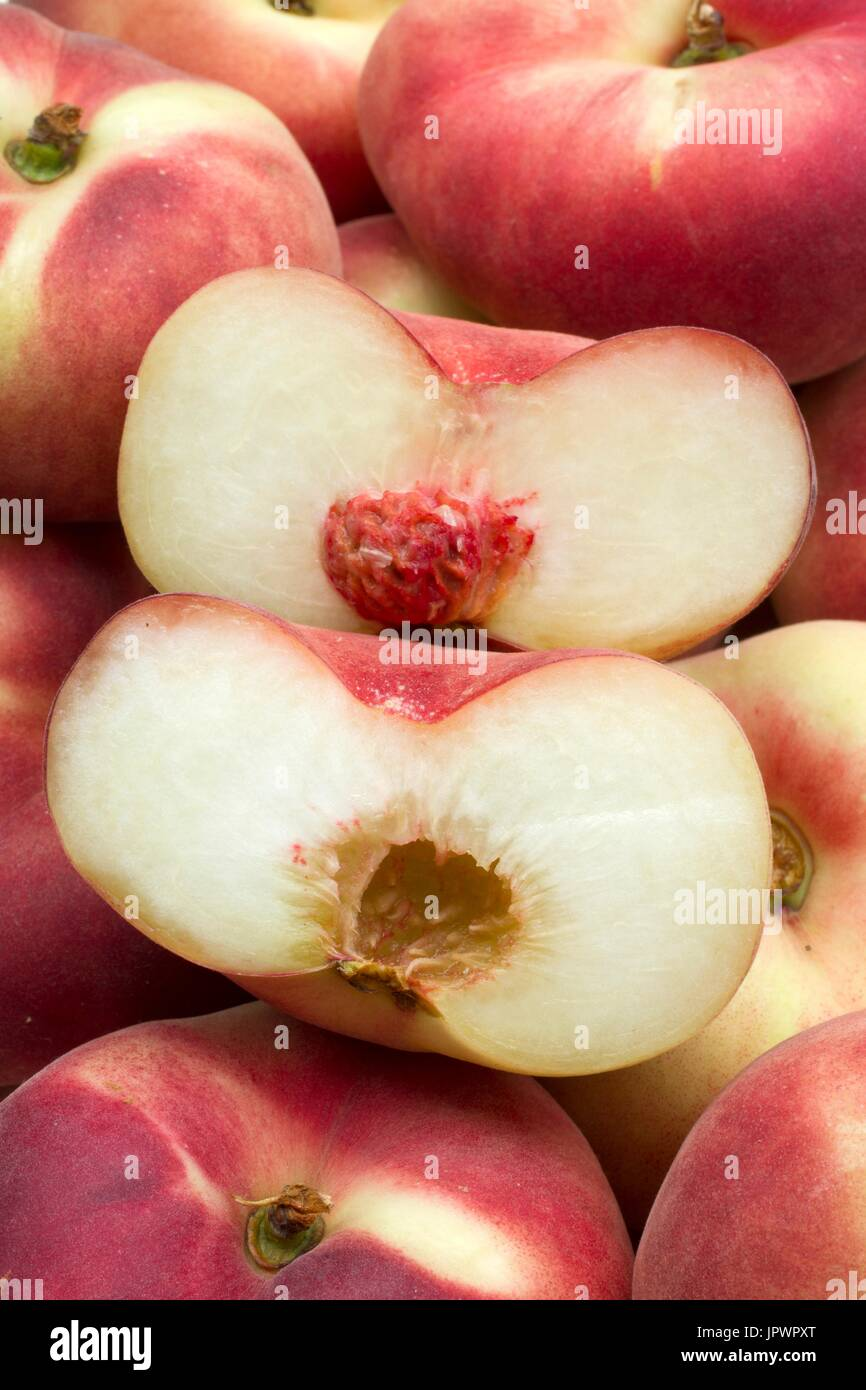 Peaches 'Sweet Cap' Saturn peach - Stock Image