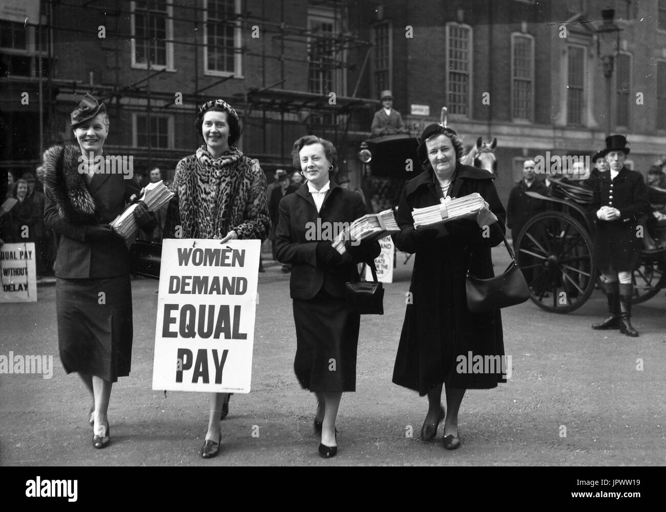 Women MPs delivering a a petition of 80,000 signatures supporting equal pay for women to the House of Commons in March 1954. Left to right, Dr Edith Summerskill MP for Fulham West, Patricia Ford ,Barbara Castle (Blackburn) and Irene Ward (Tynemouth). - Stock Image