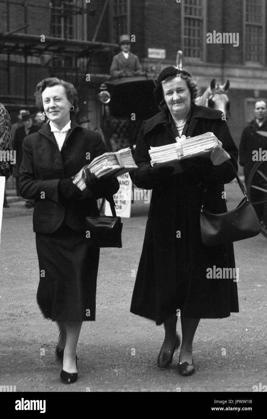 Women MPs delivering a a petition of 80,000 signatures supporting equal pay for women to the House of Commons in March 1954. Left to right Barbara Castle (Blackburn) and Irene Ward (Tynemouth). - Stock Image