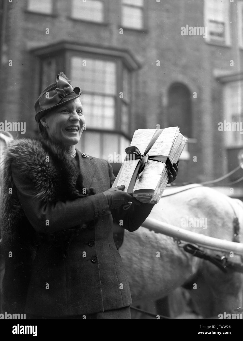 Fighting for equal pay for women March 1954. Dr Edith Summerskill MP for Fulham West arrives at the House of Commons with a petition of 80,000 signatures. - Stock Image