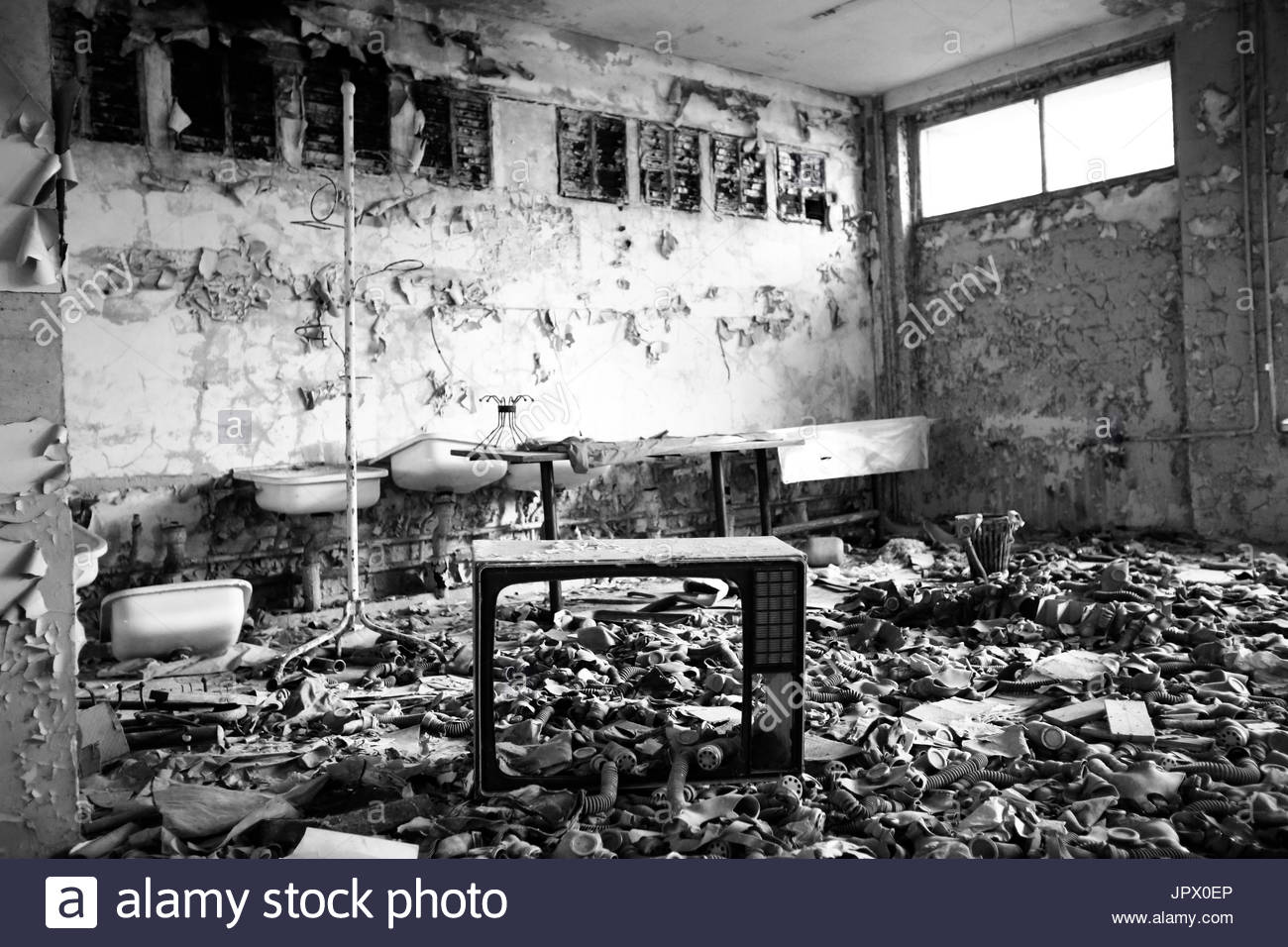 Gas masks abandoned in a classroom - Ukraine - Stock Image