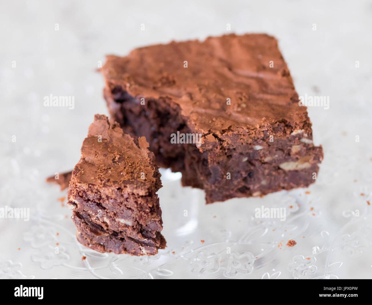 A chocolate fudge brownie. - Stock Image
