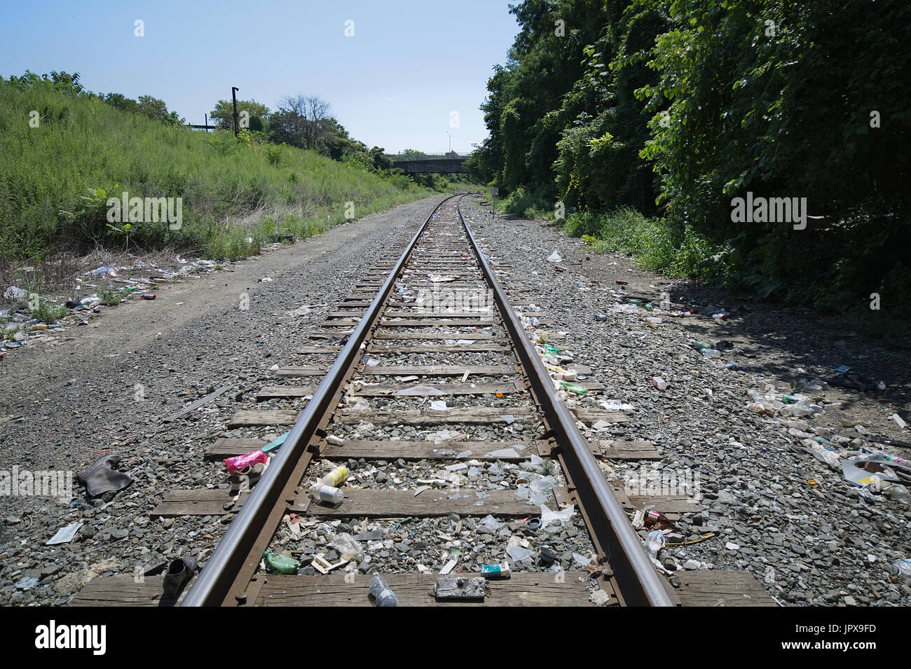 Single freight train track used by Conrail curves under North Mascher St Bridge in the Fairhill/West Kensington section of Philadelphia, Pennsylvania. - Stock Image