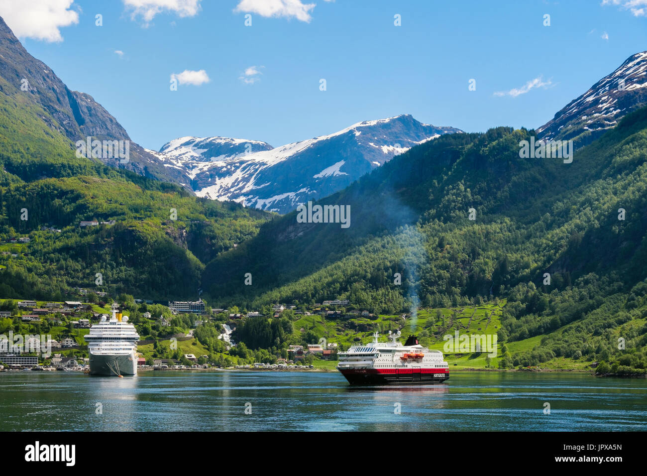 Cruise ships ocean liner and Hurtigruten cruise ship Polarlys in anchored offshore in summer. Geirangerfjorden or Stock Photo