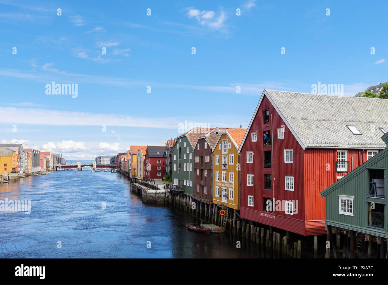 Colourful historic wooden warehouse buildings on stilts on River Nidelva waterfront in the old town. Trondheim, Stock Photo