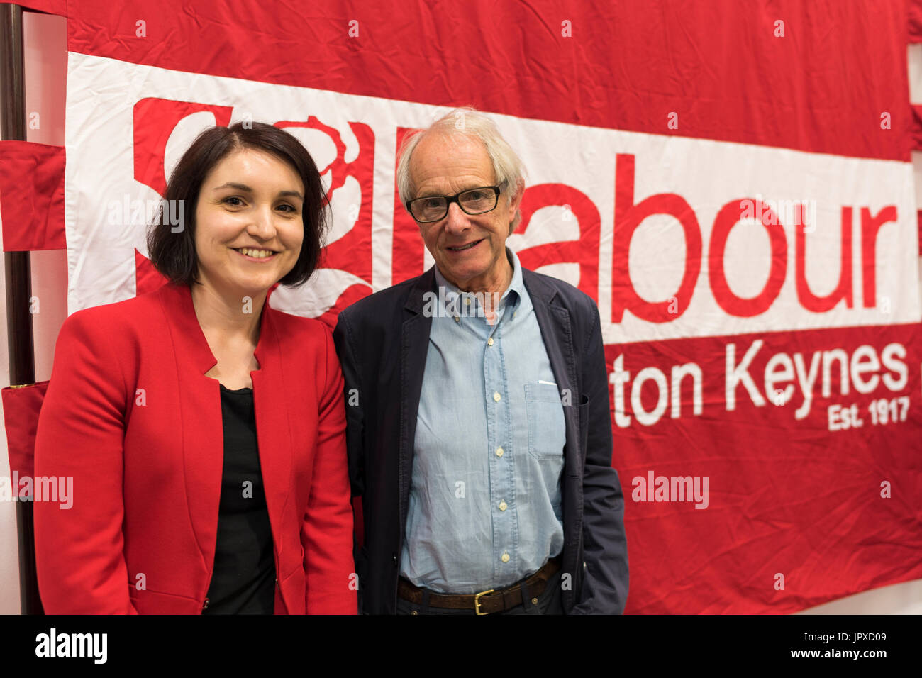Film director Ken Loach with Charlynne Pullen (Labour candidate for Milton Keynes North in 2017) photographed against a Labour Party banner. - Stock Image
