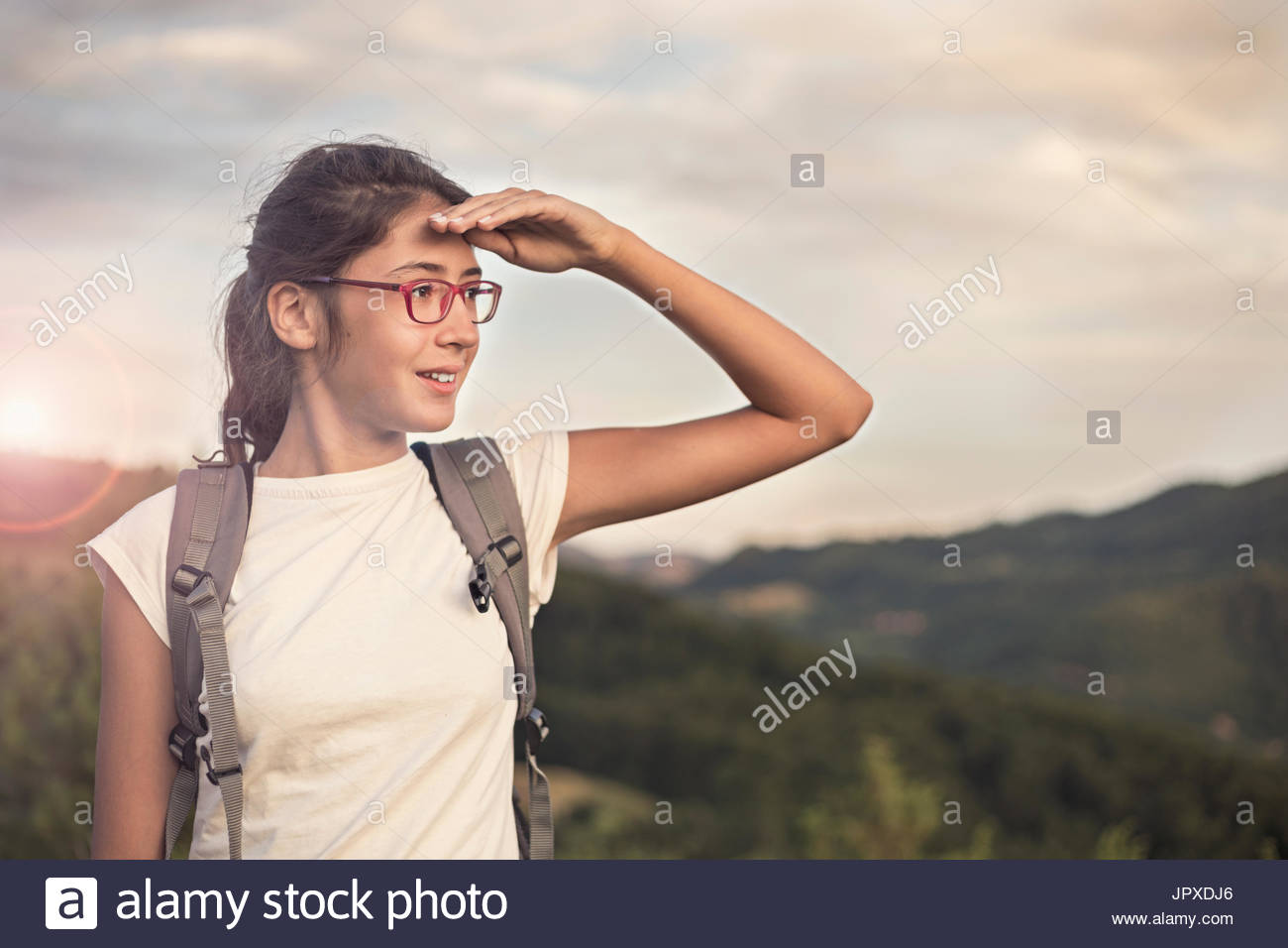 Hiker woman looking forward in the mountain - Stock Image