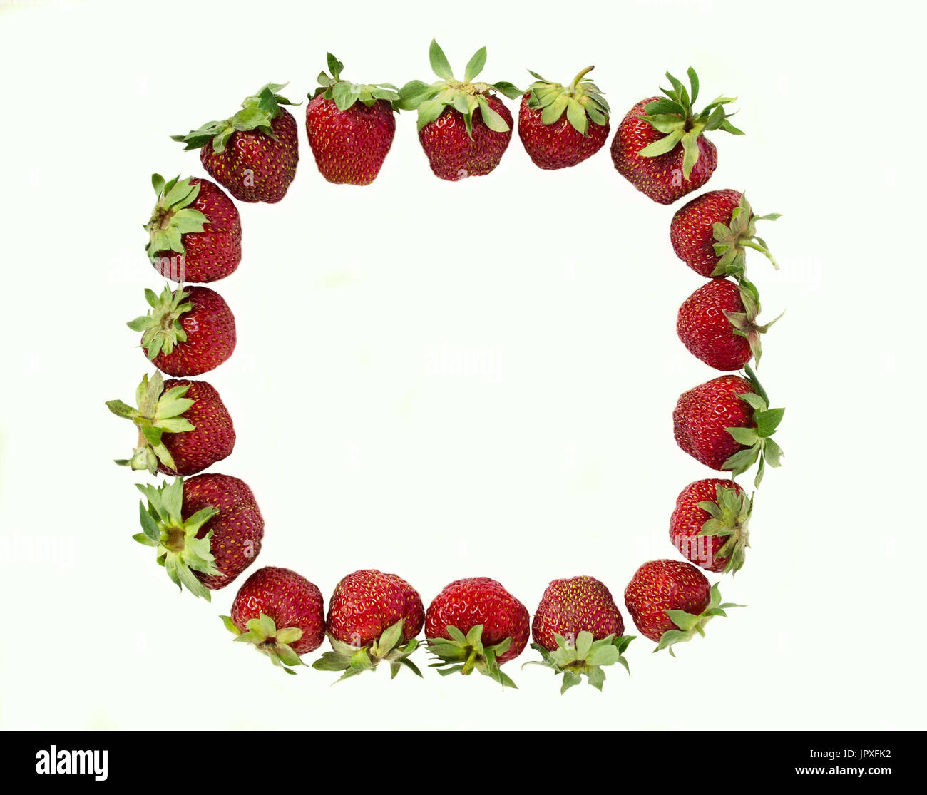 A strawberry frame on a white background. Isolate. Copy space. - Stock Image