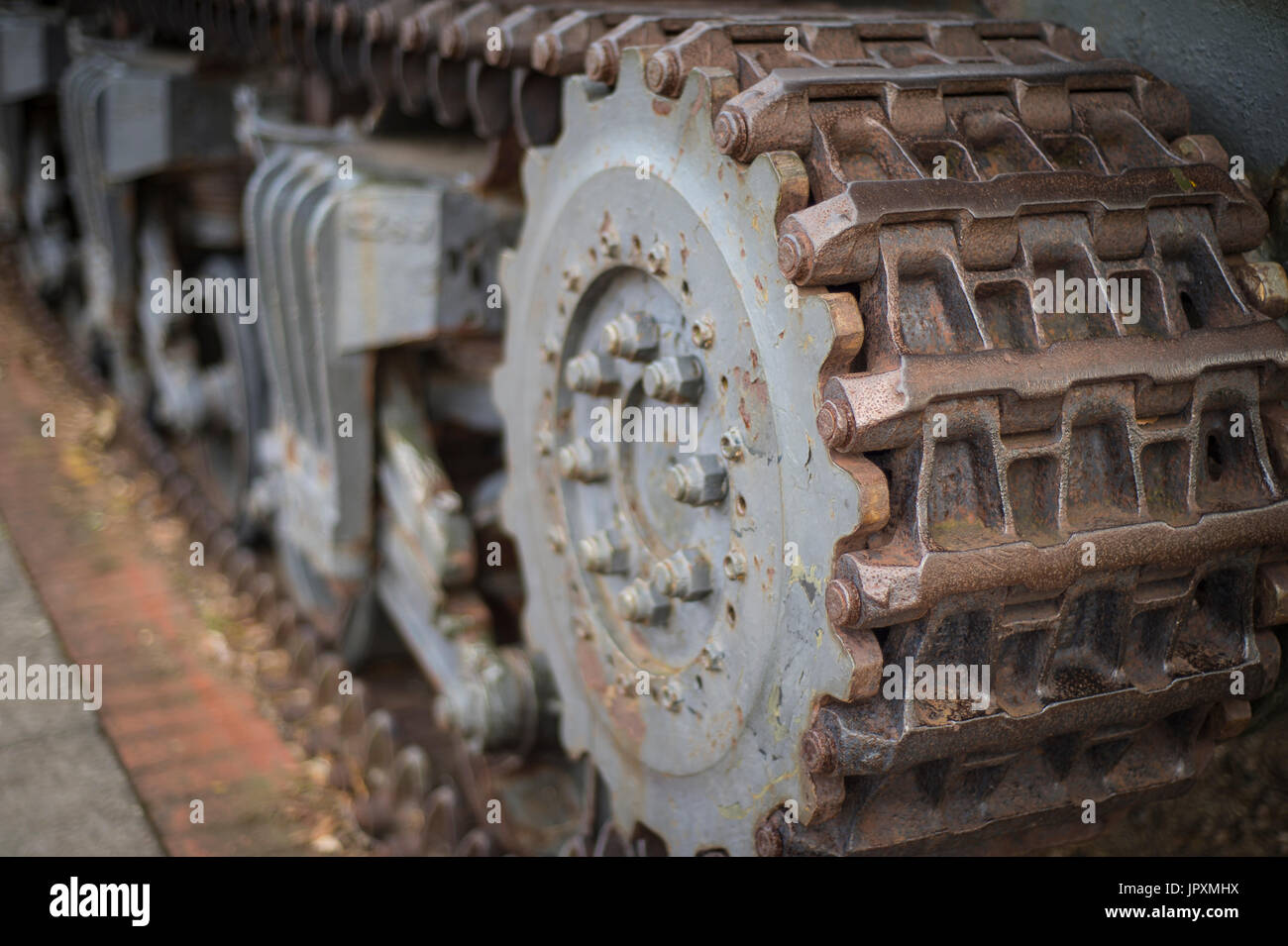 closeup of of a tank tracks and drive mechanism - Stock Image