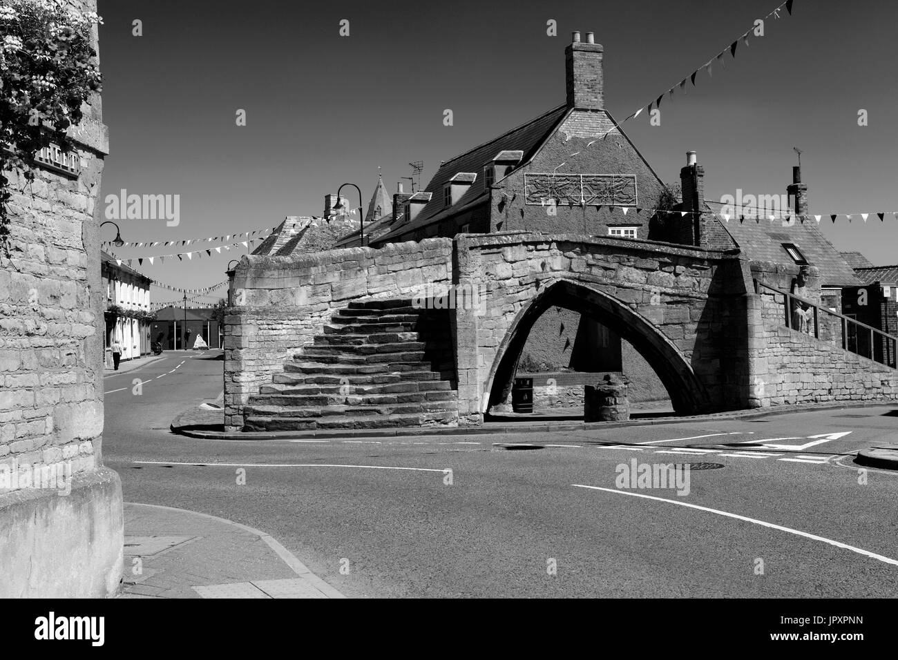 The Trinity Bridge, a 14th Century three-way stone arch bridge, Crowland town, Lincolnshire, England, UK - Stock Image