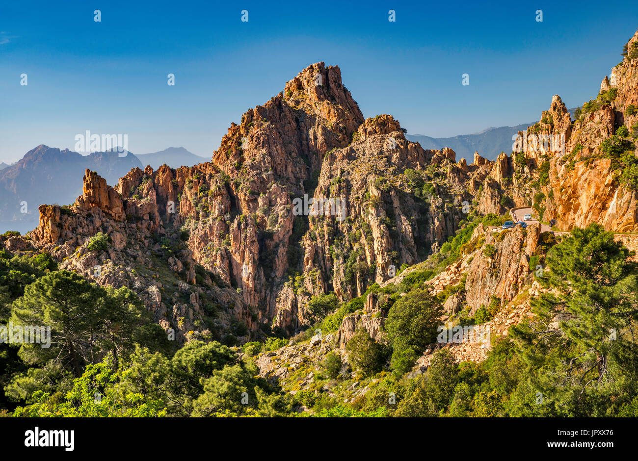 Orange porphyritic granite rocks, at Les Calanche de Piana, UNESCO World Heritage Site, Corse-du-Sud, Corsica, France Stock Photo