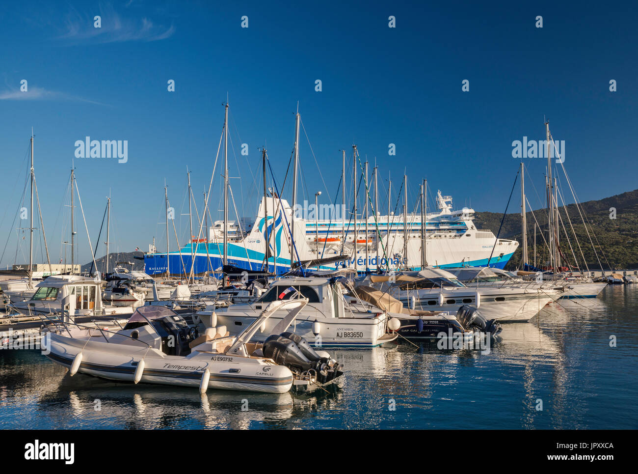 Sailboats at marina, M/F Kalliste ferry at pier behind, at Golfe de Valinco, Propriano, Corse-du-Sud, Corsica, France - Stock Image