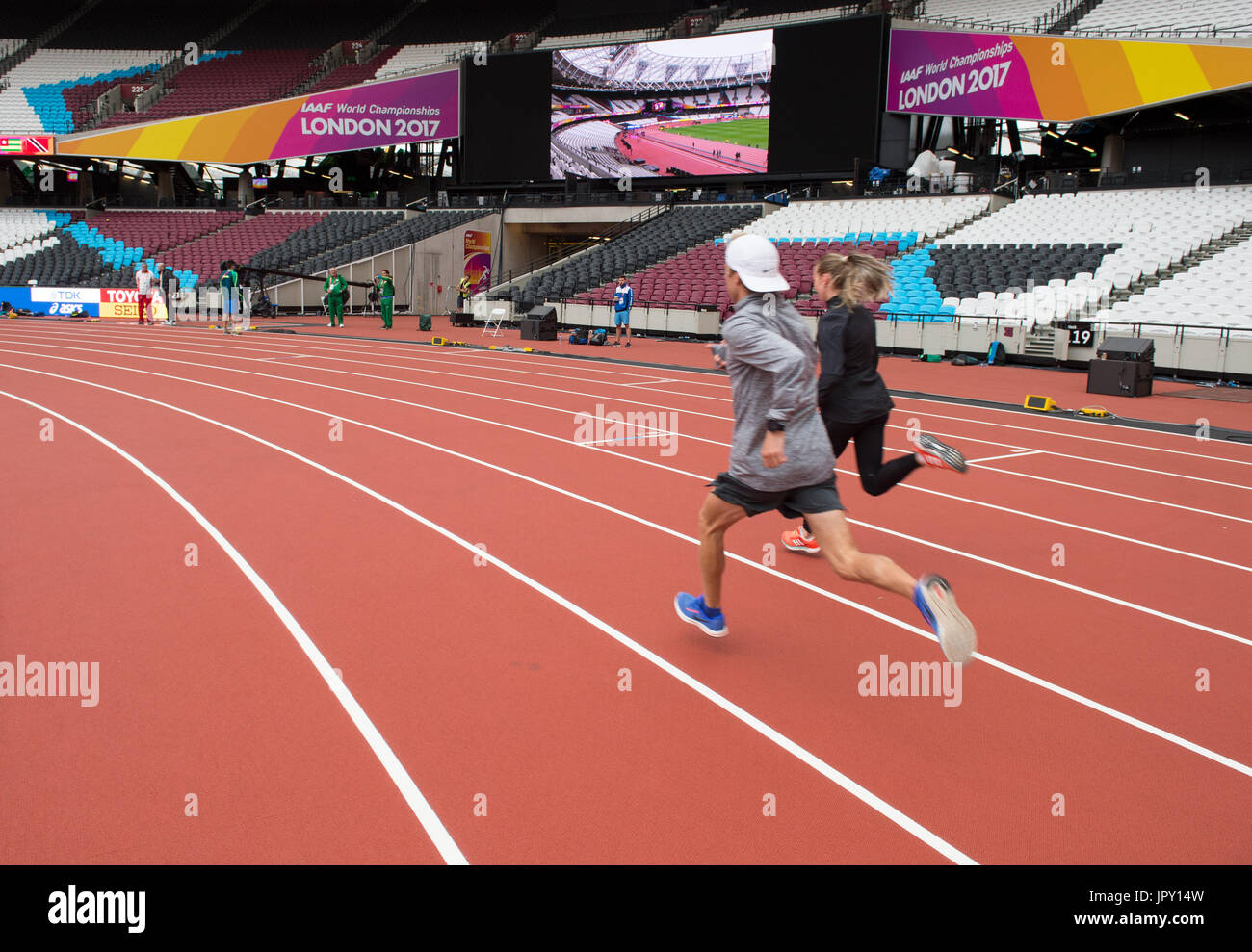 London, UK. 2nd Aug, 2017. Athletes run in the interior space of the Olympic Stadium in London, Britain, on 2 August, Stock Photo